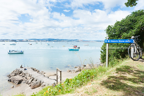 Scene over Pilot Bay from Historic Stone Jetty and sign on Base Track Mount Maunganui.