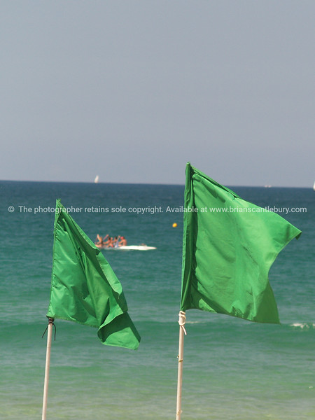 """Tauranga scenics.<br /> <br /> Two green beach flags at Mount Maunganui, Tauranga, New Zealand. Tauranga is New Zealands 5th largest city and offers a wonderfull variety of scenic and cultural experiences. Tauranga stock images Tauranga scenics. See;  <a href=""""http://www.blurb.com/b/3811392-tauranga"""">http://www.blurb.com/b/3811392-tauranga</a> mount maunganui landscape photography, Tauranga Photos; Tauranga photos, Photos of Tauranga Also see; <a href=""""http://www.brianscantlebury.com/Events"""">http://www.brianscantlebury.com/Events</a>"""