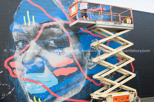Model/Property Release; No for editorial and personal use only please. Askew One street artists completing Madison at 13 Totara Street in Mount Maunganui Street Art Festival Design Depot building.