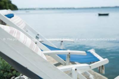 Deckchairs on waterfront.