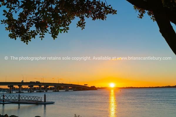 Sunrise  glows across harbor