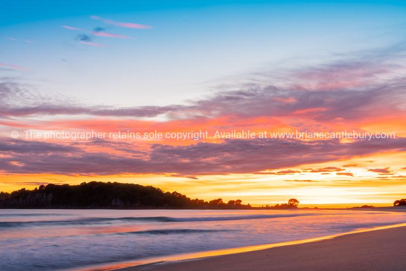 Brilliant sunrise along Mount Maunganui Mainbeach