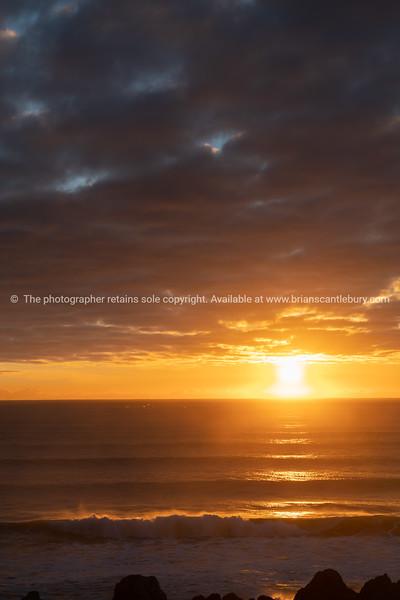 Brilliant golden sunrise over ocean