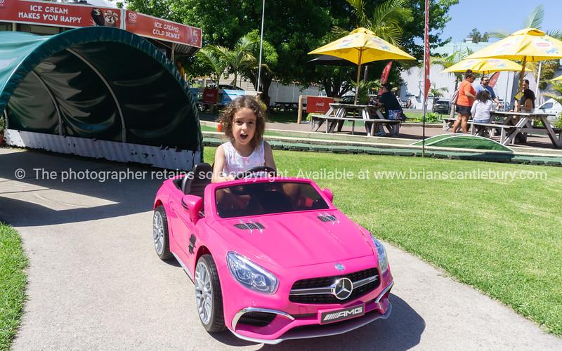 Macy in pink Mercedes battery car.