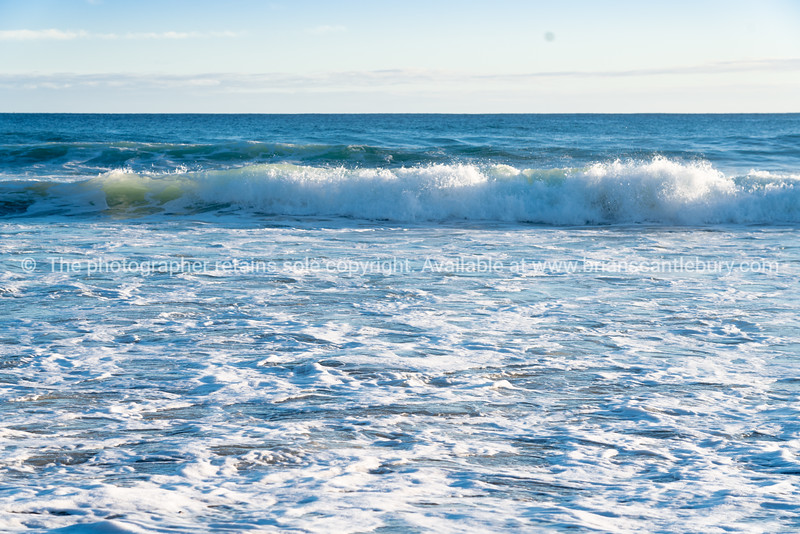 Breaking waves and and beach foam