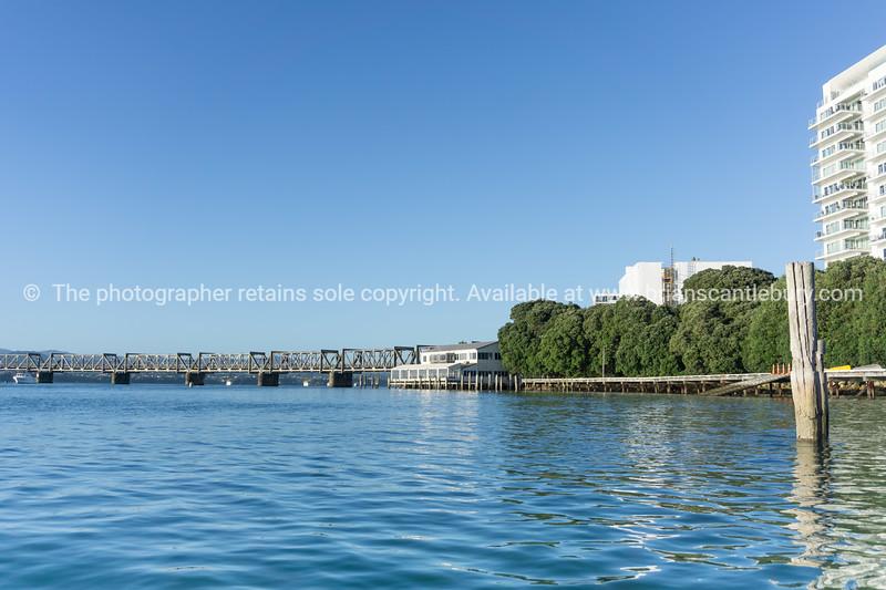 Tauranga harbour and high-rise apartment building