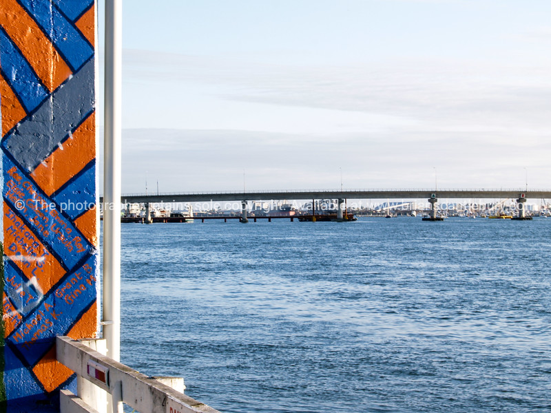 Tauranga Harbour Bridge, from the Dive Crescent old wharf sheds.