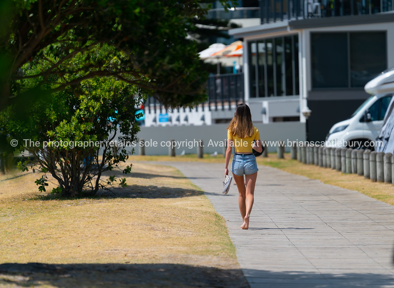 Teenager aged girl walks alone and away
