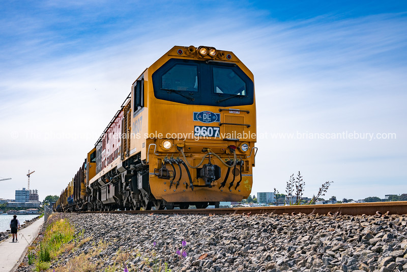 Locomotive hauling load approaching from low point of view