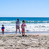 Beach fun, family playing on Papamoa beach on a summer day.