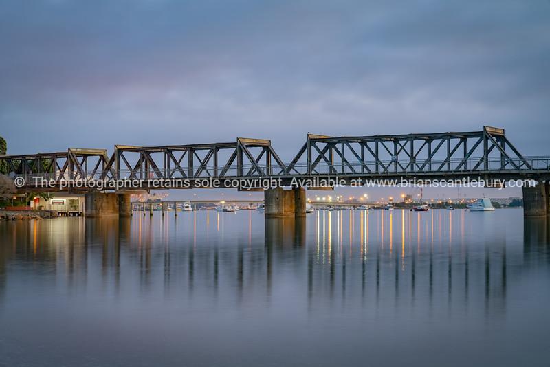 Tauranga's historic steel truss railway bridge in morning light