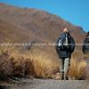 Couple set off on Tongariro Alpine Crossing, one the New Zealand Great Walks.