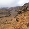 Rocky alpine landscape  with valley between ranges running into distance on Tongariro Alpine Crossing, New Zealand
