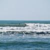 Surfers Tora Beach.  New Zealand images.