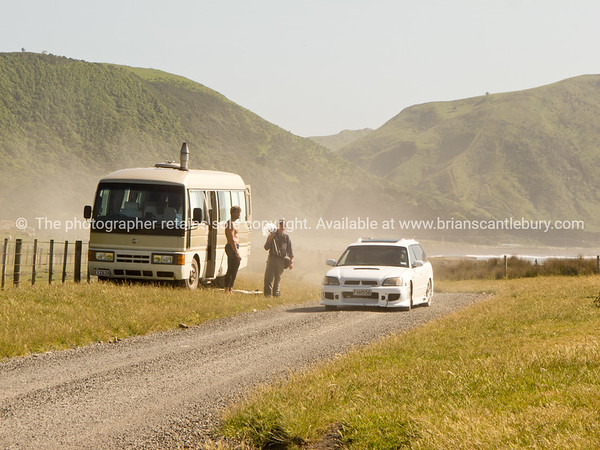 Traveller meets local. Tora. Tumbled. Old farm buildings. New Zealand images.