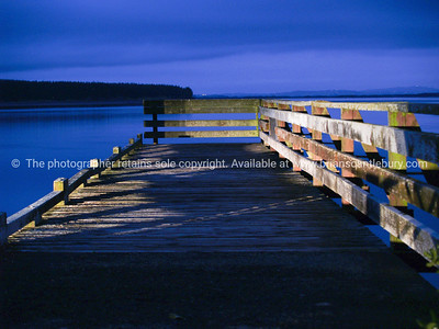 Port Waikato wharf night light.