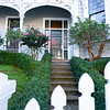 From street steps beyond gate leading through garden to front door of early 20th century design villa