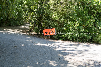 Orange sign directing way for cycling