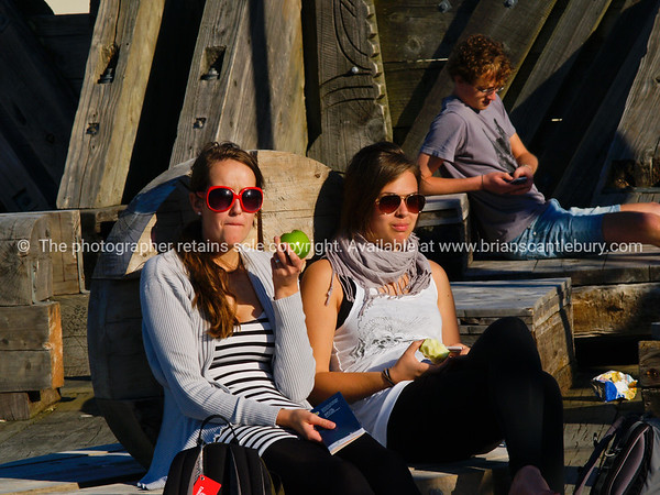 Attractive young woman sitting by the City to Sea bridge