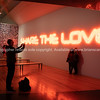 WELLINGTON NEW ZEALAND - SEPTEMBER 30 2018; Installation in Te Papa Museum, Share The Love illuminated text with people being photographed under.