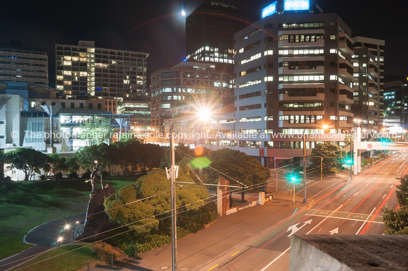 City lights across Jervois Road with The Rugby World Cup Celebration sculpture in small park  Wellington New Zealand