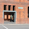 Gallery opening into street with windows above of heritage wool shed known as Shed 21 on Waterloo Quay, Wellington
