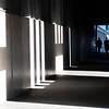 Shadows and light through openings in building gallery