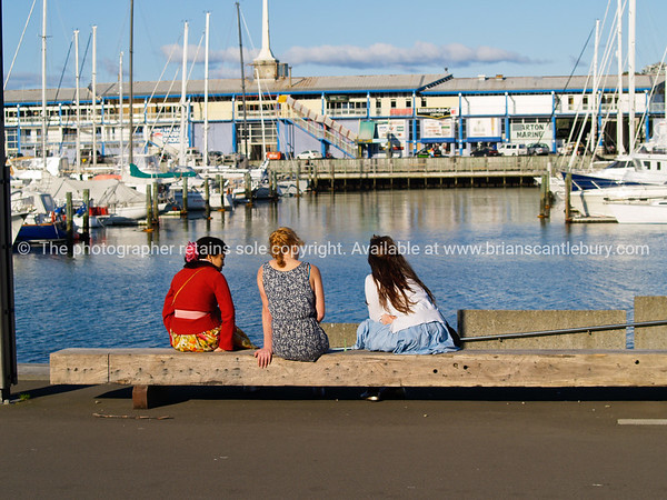 Three young people one Wellington waterfront.
