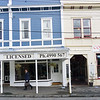 Wellington architecture two suburban restaurants  with man carrying satchel waliky by in Tinakori Road Wellington.