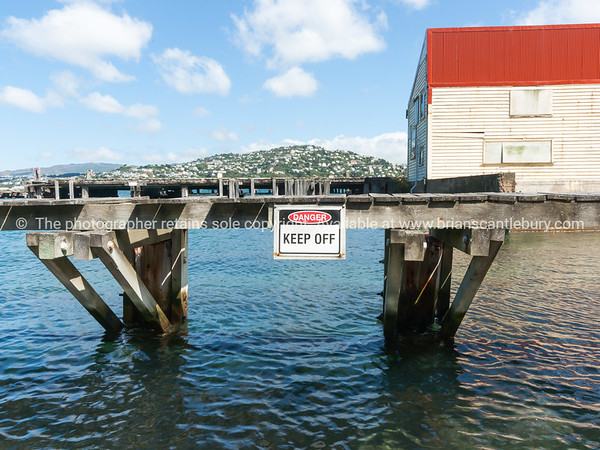 Danger sign on old pier