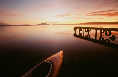Kayak on Lake Rotorua at sunrise, North Island