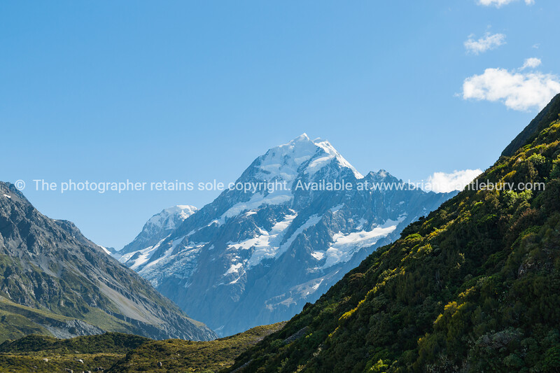 Sunrise sunshine strikes snow-capperd Mount Cook