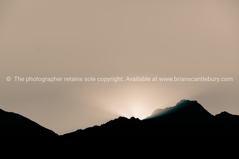 Silhouette line of mountain range as sunsets behind for backgound or effects.