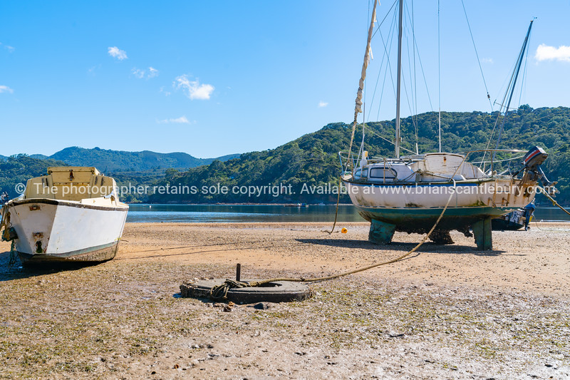 Boats lying on beach at low tide on Shoal Bay