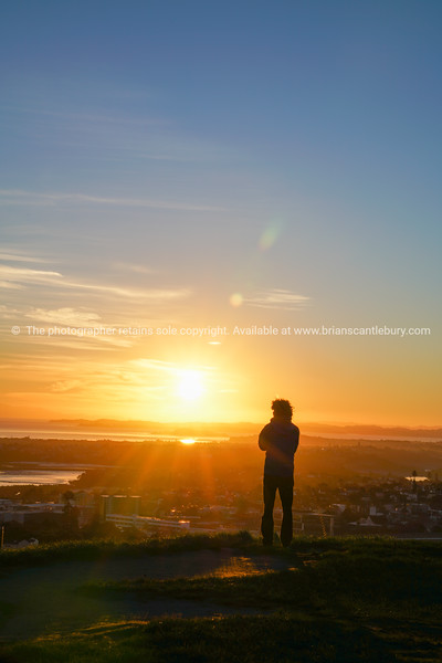 Sunrises over Auckland from top Mount Eden