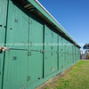 Green dinghy lockers of Devonport foreshore.