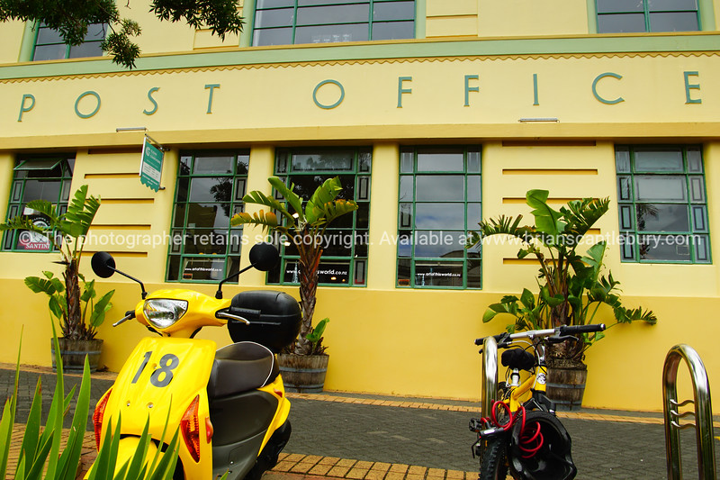 Devonport, old Post Office building, yellow exterior with yellow moped and pushbike
