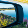 Beautiful landscape view in rear vision mirror