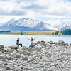 Young tourists  enjoy experience of rocky foreshore