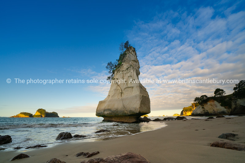 Te Hoho Rock standing by Cathedral Cove it's pumice weathered over thousands of years looking like it is about to topple,