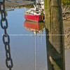 Red boat on Waitakaruru river
