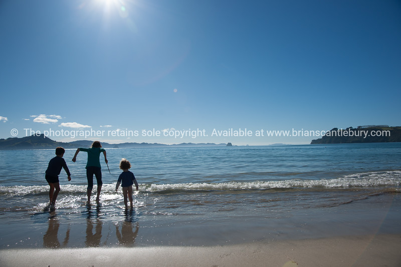 Beach fun, children playing in  the shallows.