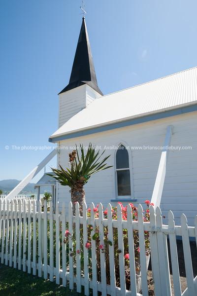 Picket fence around White Raukokore Historic Church. East Coast, New Zealand images