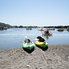 Quiet Whanarua Bay kayaks and boats. New Zealand images.
