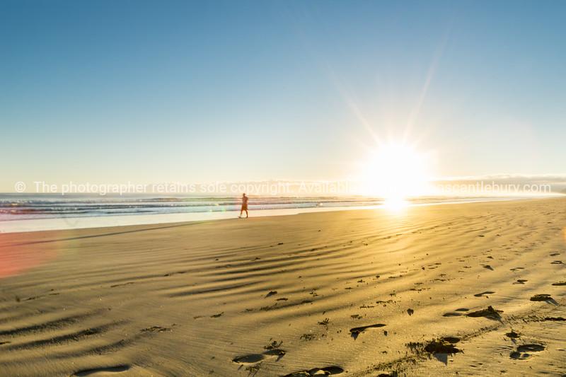 Sunrise over wide flat sandy beach at Ohope Whakatane