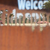 Die cut steel welcome sign. Cape Kidnappers. New Zealand images.