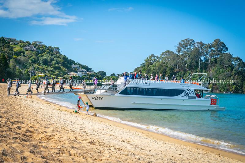 Tourists disembark onto Kaiterteri Beach Tasman New Zealand