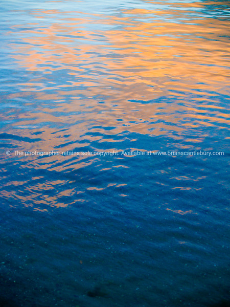 Golden glow on blue abstract.