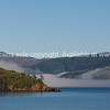 Scenic Marlborough Sounds, green hills, blue sea and low cloud.  New Zealand images.