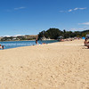 Golden Bay beach and sunbathers. New Zealand image.